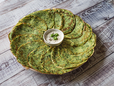 Gluten free spinach pancakes on a wooden table Stok Fotoğraf