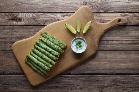 Spinach Adai - Indian green pancakes. Vegetarian food. Stock Photo
