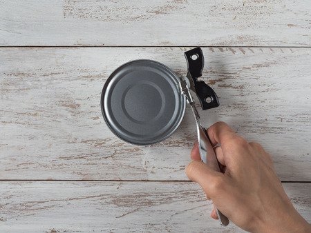 Canning knife opens the jar. Top view