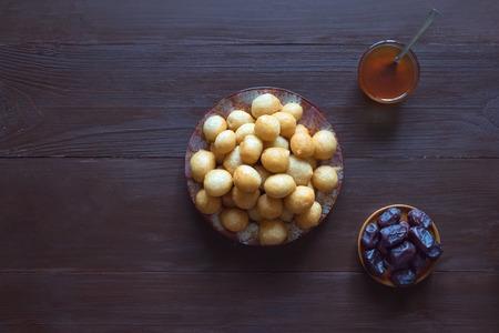 Arabic traditional Ramadan dessert Zalabya. Middle Eastern dessert Loukoumades.