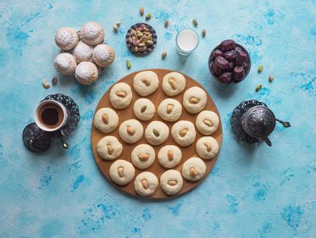 Ghorayeba sweets. Eid eats. Cookies of El Fitr Islamic Feast. Ramadan sweets background.