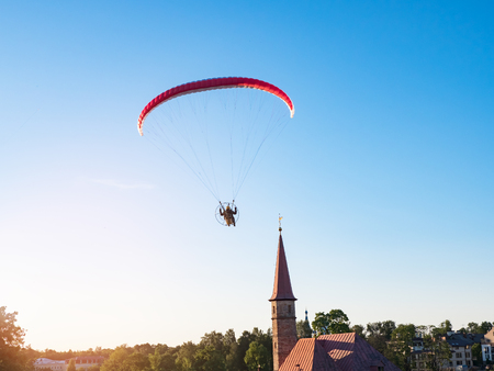 Extreme sports. Powered parachute against the blue sky. Stock Photo