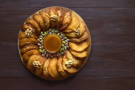 Arab sweets. Arabian pancake stuffed with sweet cheese and pistachios.