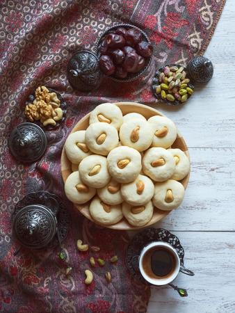 Eid eats. Ghorayeba sweets. Cookies of El Fitr Islamic Feast. Ramadan food background.