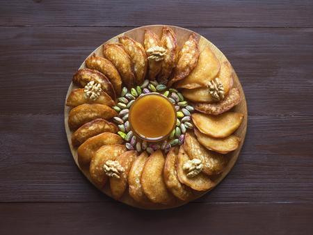Qatayef, Arabic sweets for Ramadan. Fried Qatayef.