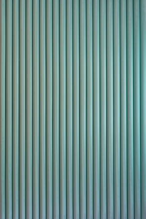 Striped background. Vertically structure of repeated green rolls. Stock Photo