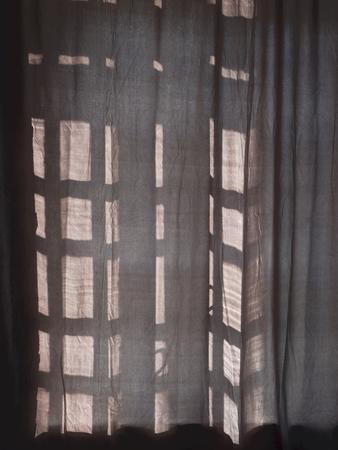 Dark curtains close the Sunny window. Dark window background