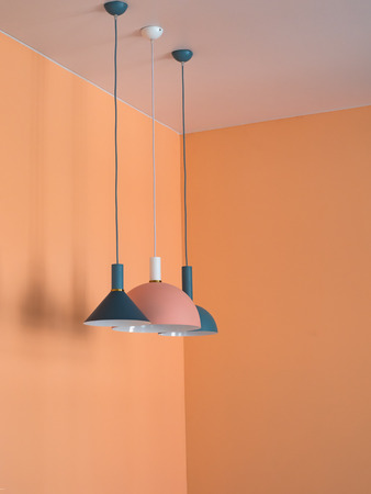 Pendant lights in orange interior. Orange room design with lights. Stock Photo