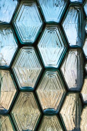 Vintage hexagon shaped window blocks wall pattern.