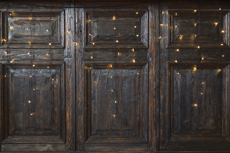 Vintage wooden wall with garlands. Wooden wall decorated by electric lamps.