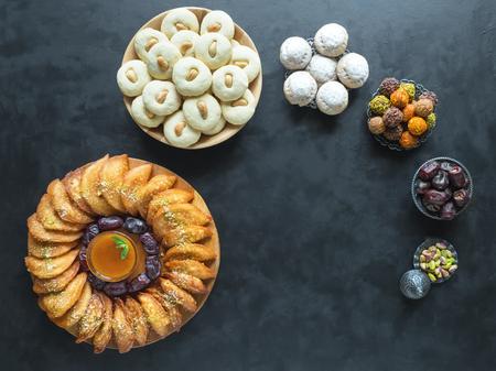 Cookies of El Fitr Islamic Feast. Ramadan food background. Arabic sweets. Arabian Qatayef.