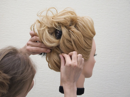 Training hair styling on a mannequin. Close up Stock Photo