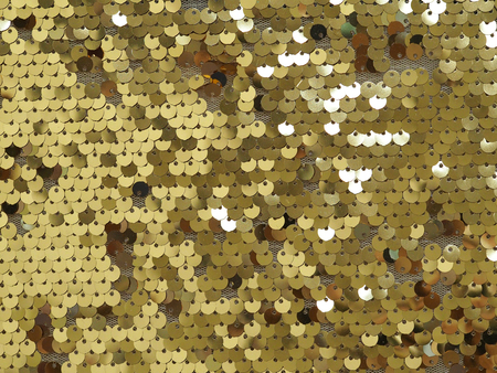 Background of gold shiny sequins. Close up