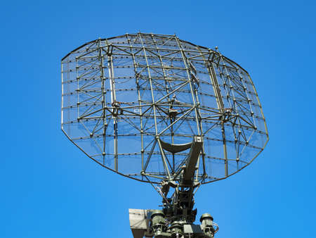 Military directional antenna on a blue sky background.