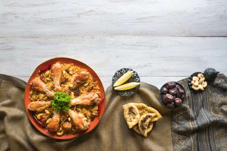 Chicken Mandi with dates. Arabic cuisine. Top view.