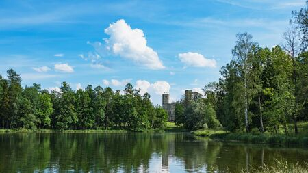Beautiful summer landscape with a pond near the old Palace. Gatchina. Russia.