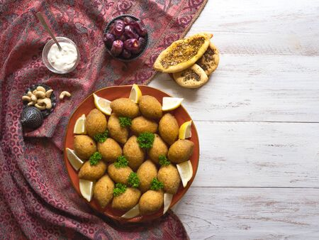 Arabic meat appetizer Kibbeh. Traditional Arabic kibbeh with lamb and pine nuts.