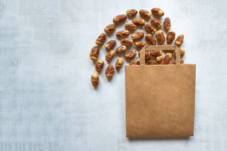 Paper bag with scattered dates on a light table with a copy of space.