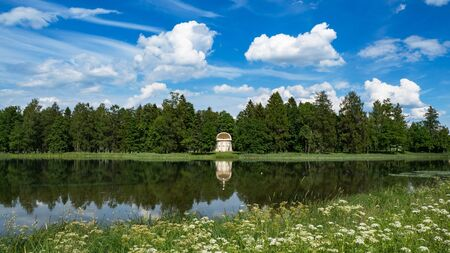 The eagle pavilion in the old Park of Gatchina. Summer minimalistic panoramic landscape with a lake in the Park