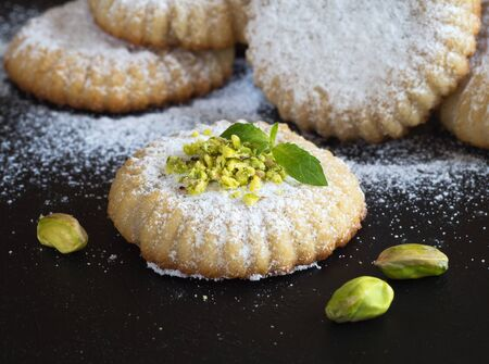 Maamoul - arabic homemade cookies filled with dates and pistachios. Close up