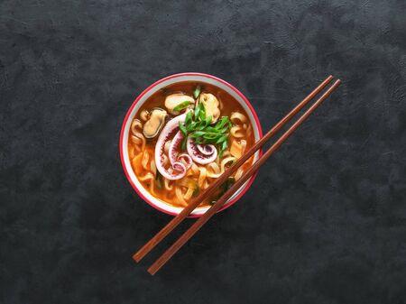 Delicious spicy seafood noodle soup. Top view, copy space Zdjęcie Seryjne