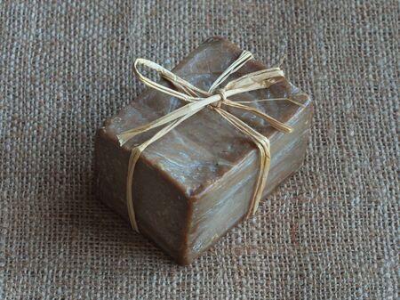 Olive oil soap handmade on burlap. Close up Reklamní fotografie