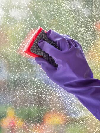 House cleaning. Washing dirty window glass detergent in winter. Stock fotó