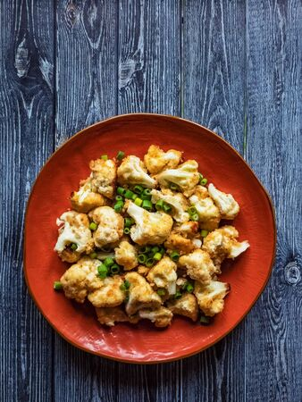 Cauliflower fried on a plate. Top view, close up Stockfoto