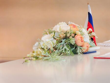 Table with a bouquet in the wedding hall. Russia.