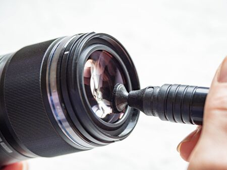 Cleaning the camera lens with a special brush. Close up.