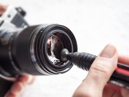 Manual cleaning of the camera lens with a special cleaning pencil 스톡 콘텐츠 - 132039406