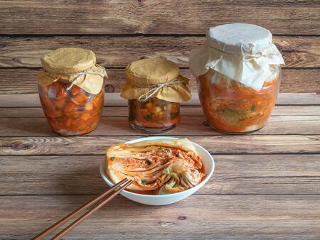 Korean kimchi from Chinese cabbage on a dark wooden table.