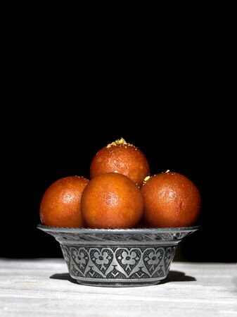 Indian traditional sweet Gulab Jamun, close up, copy space. Standard-Bild