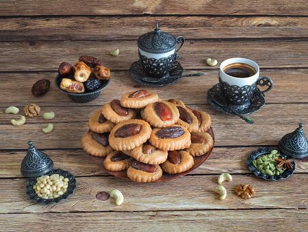 Eid Dates sweets on a wooden table. Ramadan food background.