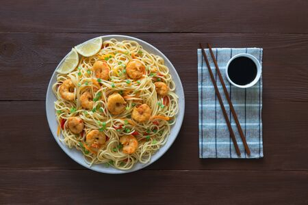Prawn Schezwan Noodles with vegetables. Top view.  Stock Photo
