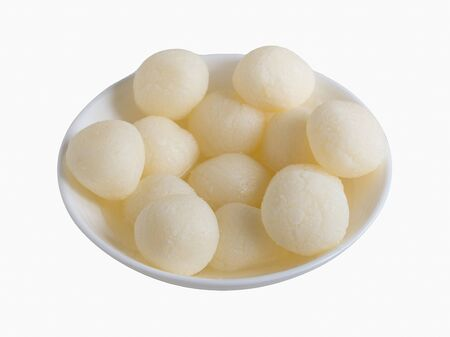 Isolated Indian traditional sweet rasgulla, close up, copy space.