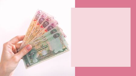 Arab dirham banknotes in hand design poster. Template for poster, banner, invitation, cover.