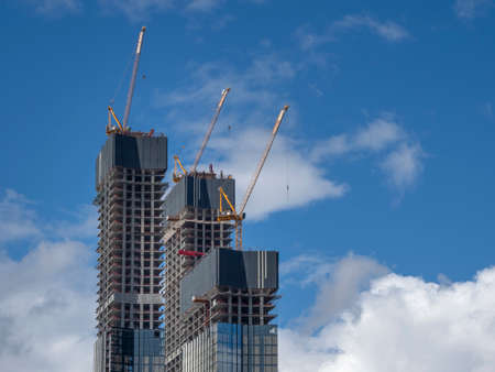 Construction work site and high rise building. High-rise building under construction. Reinforced concrete frame.