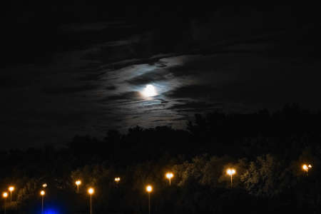 Red moon on the background of the night sky with clouds. Banque d'images