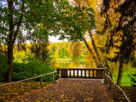 Beautiful autumn landscape with balustrade in Pavlovsk Park. Saint-Petersburg.