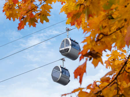 Two cabins of the cable car at the blue autumn sky Standard-Bild - 157290781