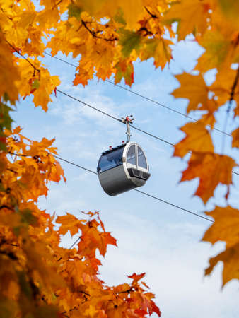 Cable car cabin against the blue sky in a autumn