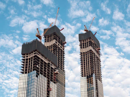 Construction work site and high rise building. Elevators lifts to the construction sites of a skyscraper under construction.