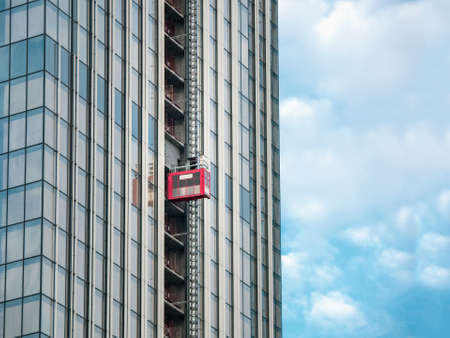 Elevators lifts to the construction sites of a skyscraper under construction. Standard-Bild
