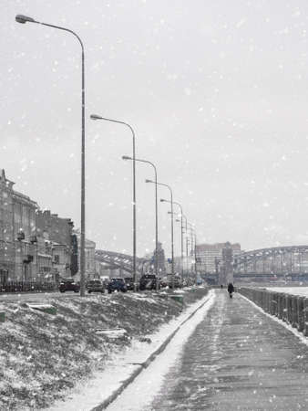 Empty winter embankment in Saint Petersburg with a view of the Neva river.