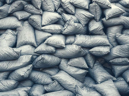 Background of a pile of filled plastic garbage bags.