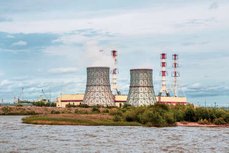 Chimneys of a power plant, an industrial district in the South-West of Saint Petersburg. Standard-Bild