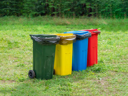 Multi-colored containers for separate garbage collection.