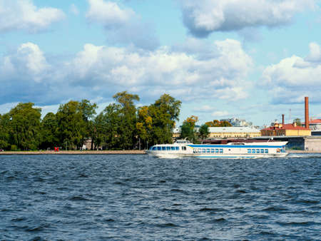 Saint-Petersburg. Speed boat taxi sailing on the river Neva.