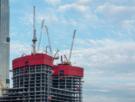 Construction work site and high rise building. High-rise building under construction. Reinforced concrete frame. Moscow.